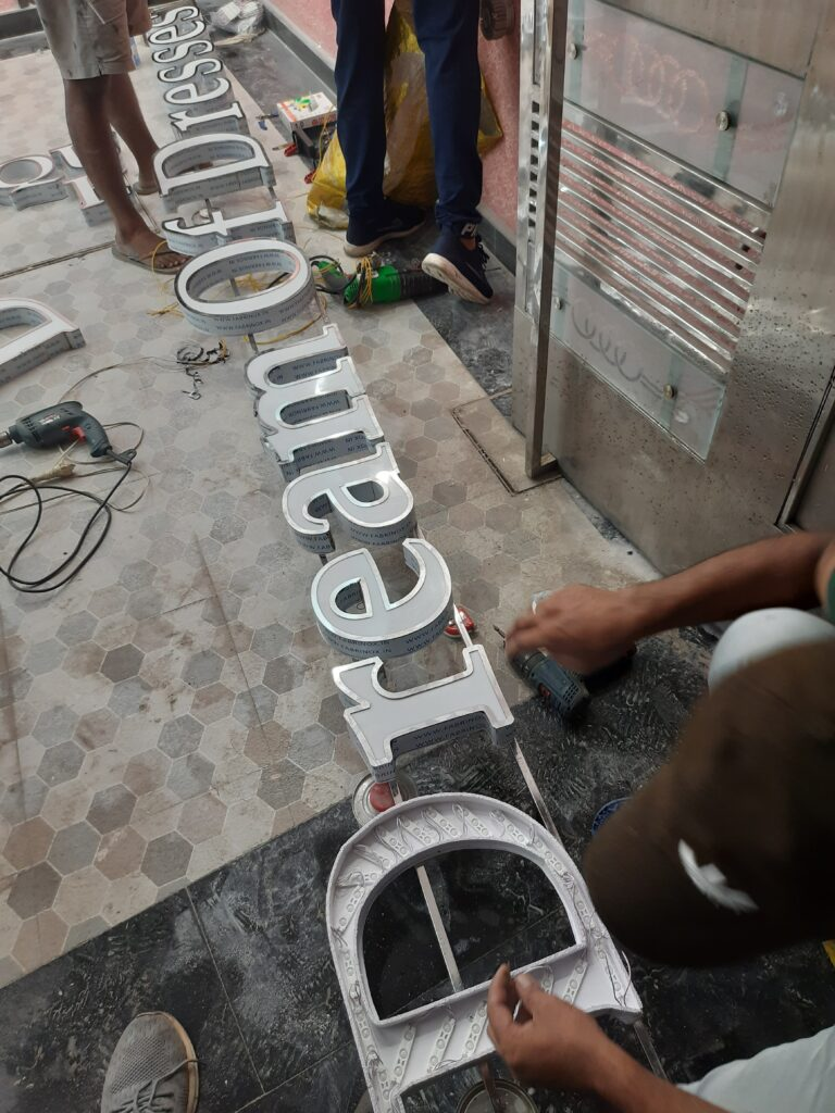 Installation of SS Letters on SS Frame in Progress.